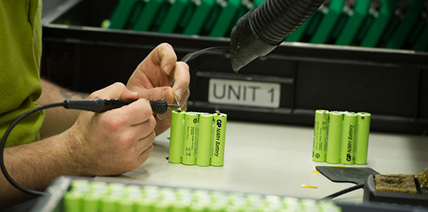 A Steatite technician assembling cells into a custom battery packs